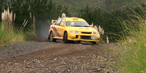 yellow rally car drift